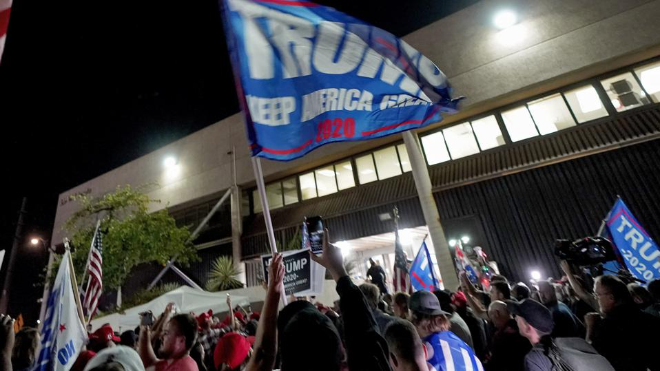 Trump supporters gather outside the Maricopa County Elections Department on Wednesday, Nov. 4, 2020.
