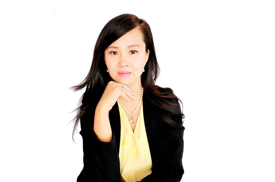 Thi Be Nguyen poses seated