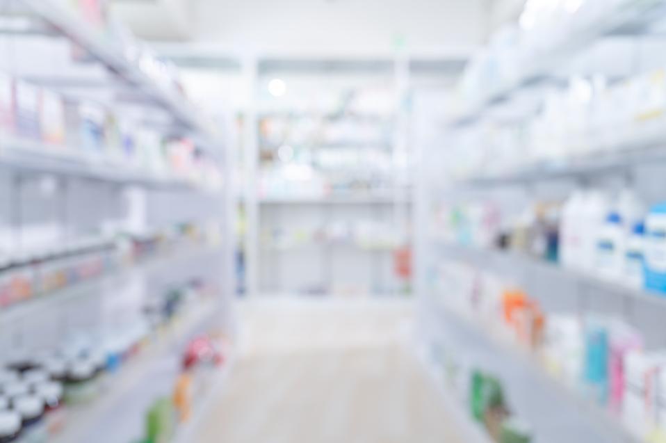 Pharmacy medicine shelf in a row blurred background