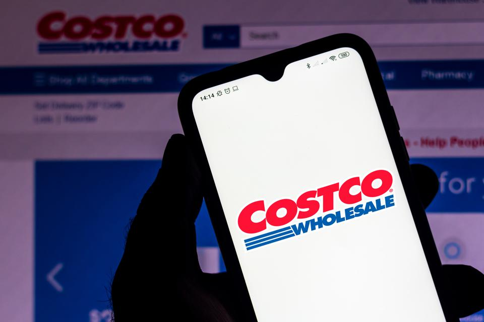 In this photo illustration the Costco Wholesale Corporation logo seen displayed on a smartphone.
