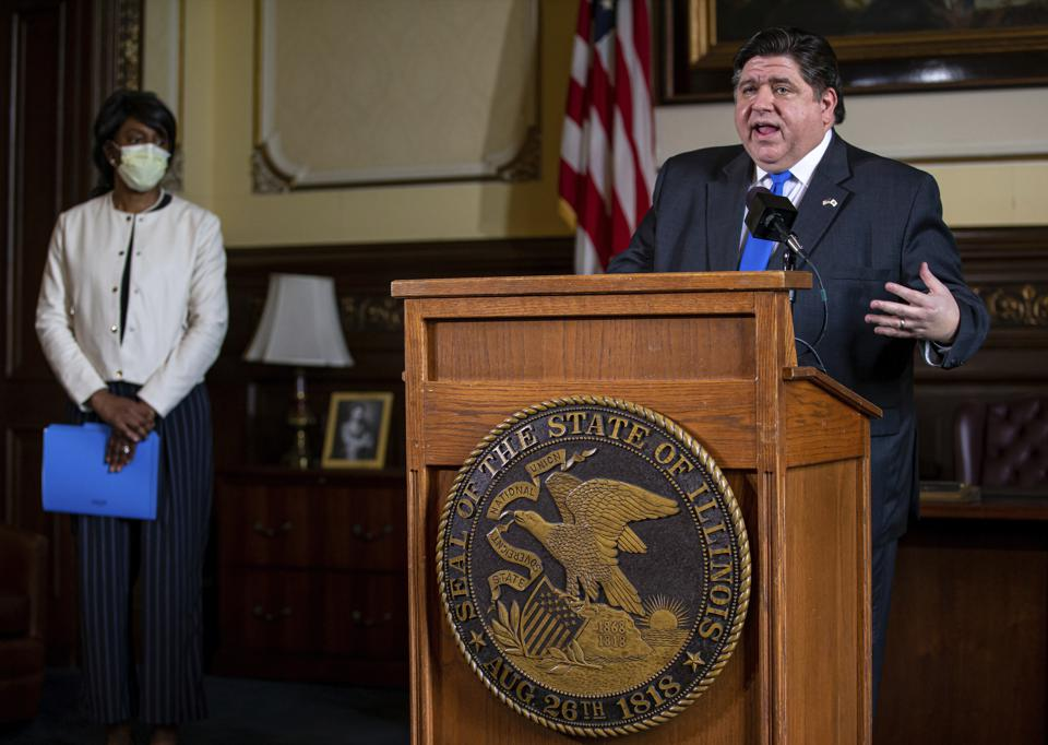 Illinois Governor J.B. Pritzker (right) and Dr. Ngozi Ezike (left), director of the Illinois Department of Public Health.