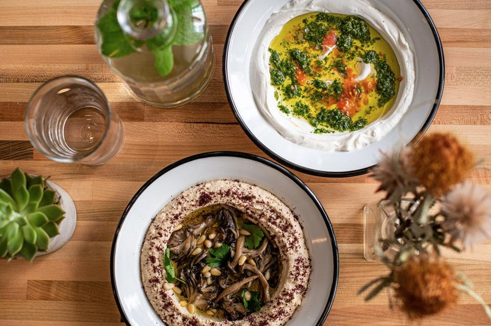 A selection of Shuk Shuka dishes created by former contributing chef, Mona Leena.