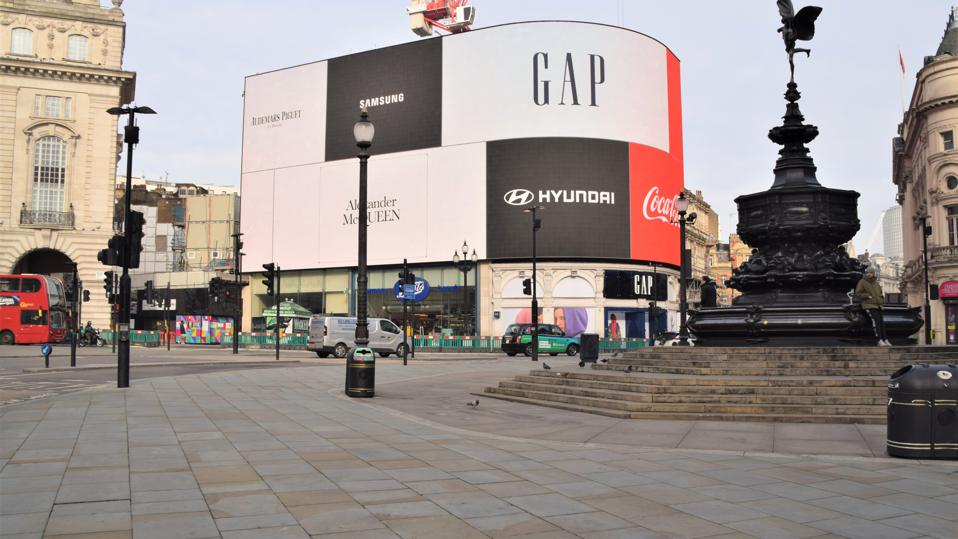 Daytime view of an empty and deserted Piccadilly Circus, London.
