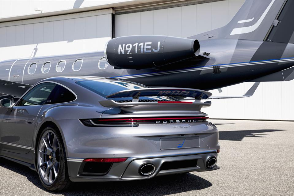 Private jet and sports car side by side