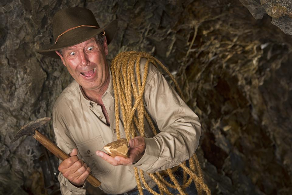 Excited Gold Miner hitting the Jackpot