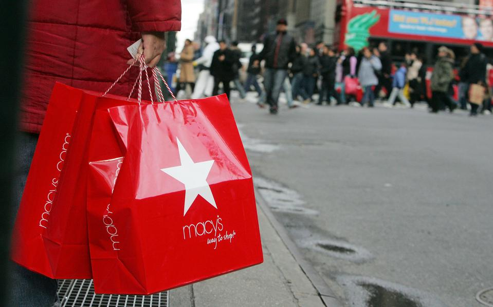 A shopper holds Macy's bags