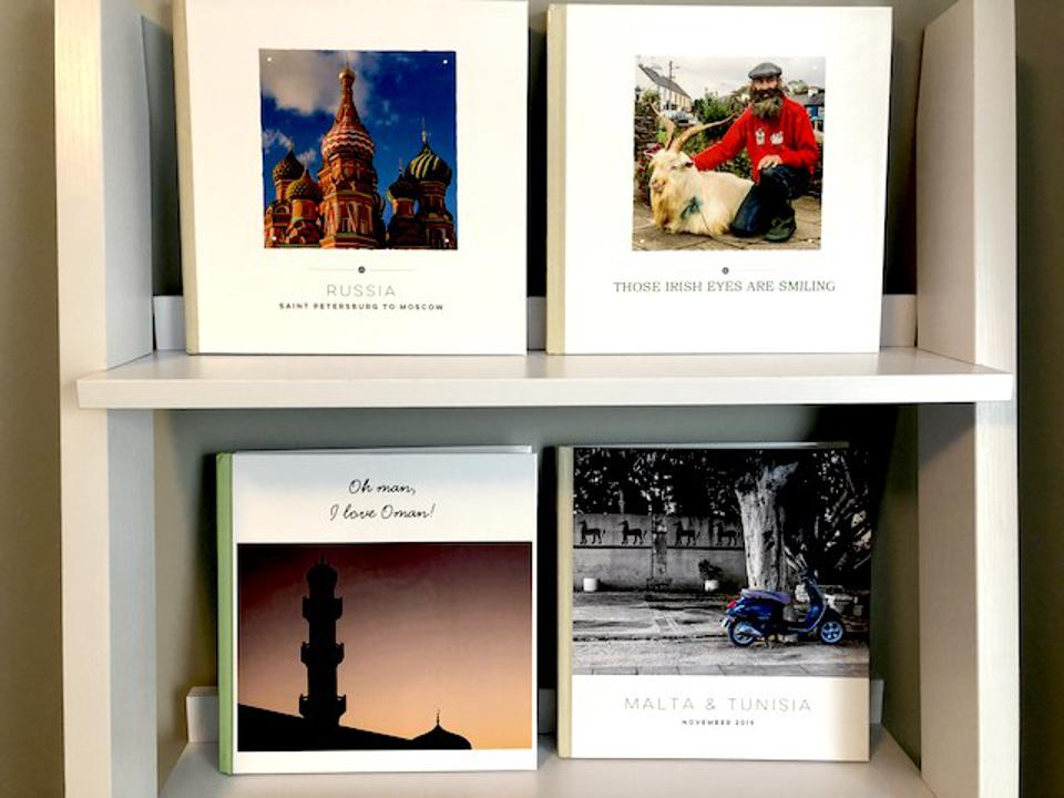 Two shelves of photo books, part of a much larger collection