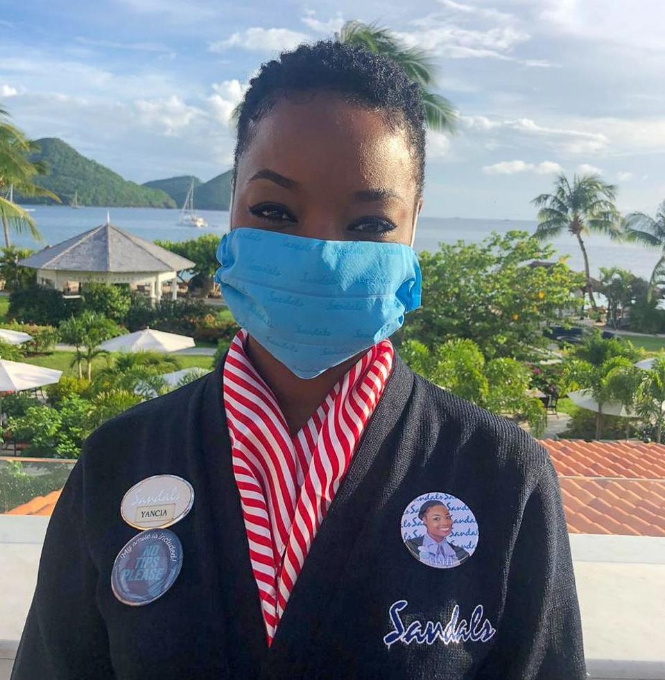 Masked staff member at Sandals