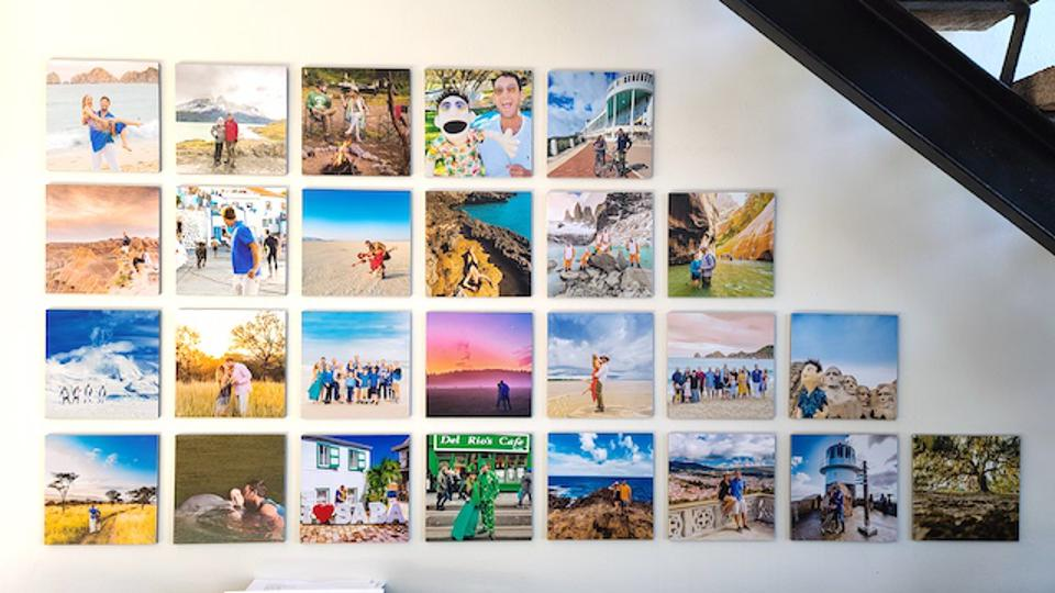A wall of photo tiles under a stairwell