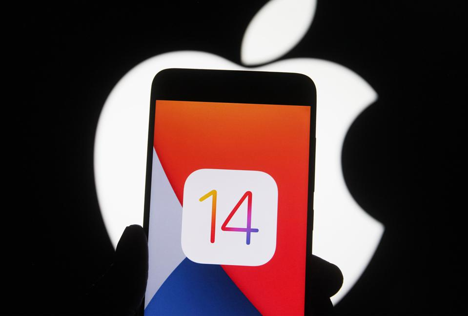 In this photo illustration the iOS 14 logo of the iOS mobile...