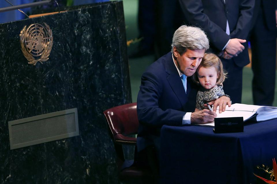 22 Apr 2016: U.S. Secretary of State John Kerry holds his two year-old grand daughter Isabel Dobbs-Higginson for the signing of the accord at the United Nations Signing Ceremony for the Paris Agreement on Climate Change.
