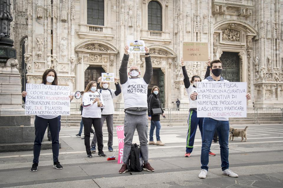 Protesters in Piazza Duomo against the closure of gyms in Milan, Italy