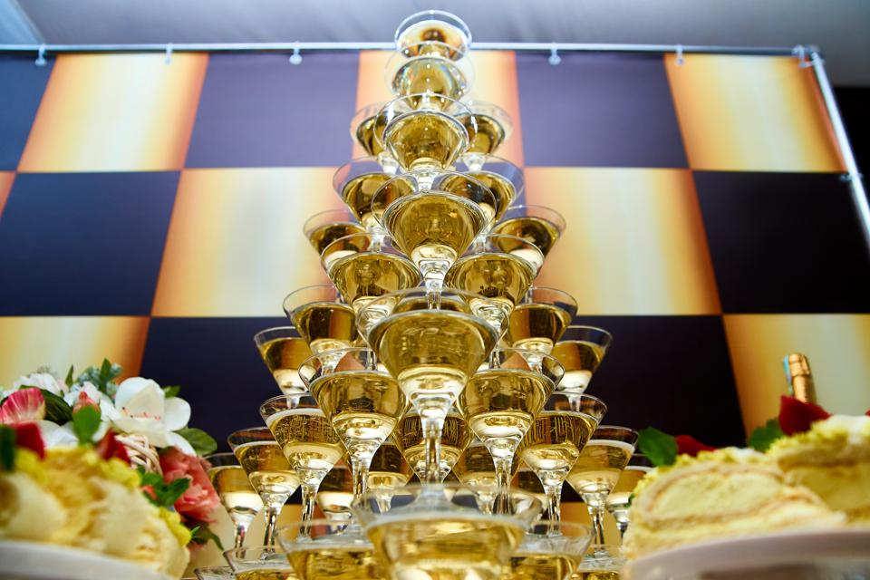 A Pyramid of champagne at a banquet.