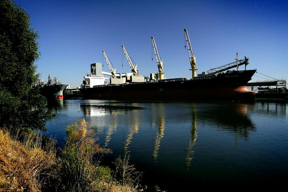 A container ship is docked in the deep canal of an inland port in the Sacramento-San Joaquin River Delta in Stockton, California.