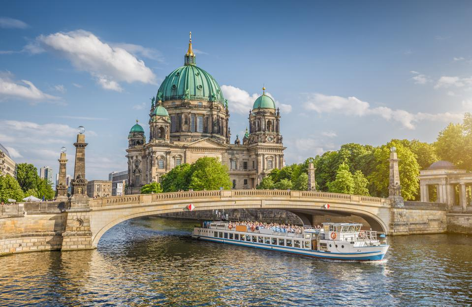 Best Places to live in Europe: Berlin Cathedral with ship on Spree river at sunset, Berlin, Germany
