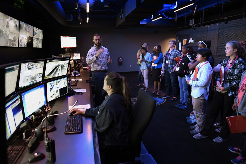 DENVER, CO - JUNE 25: Mike Christman manager of public communications for RTD explaining the workings of the RTD control center video monitoring system during the US Department of Transportation Career Days for Girls June 25, 2018 in Denver, Colorado.