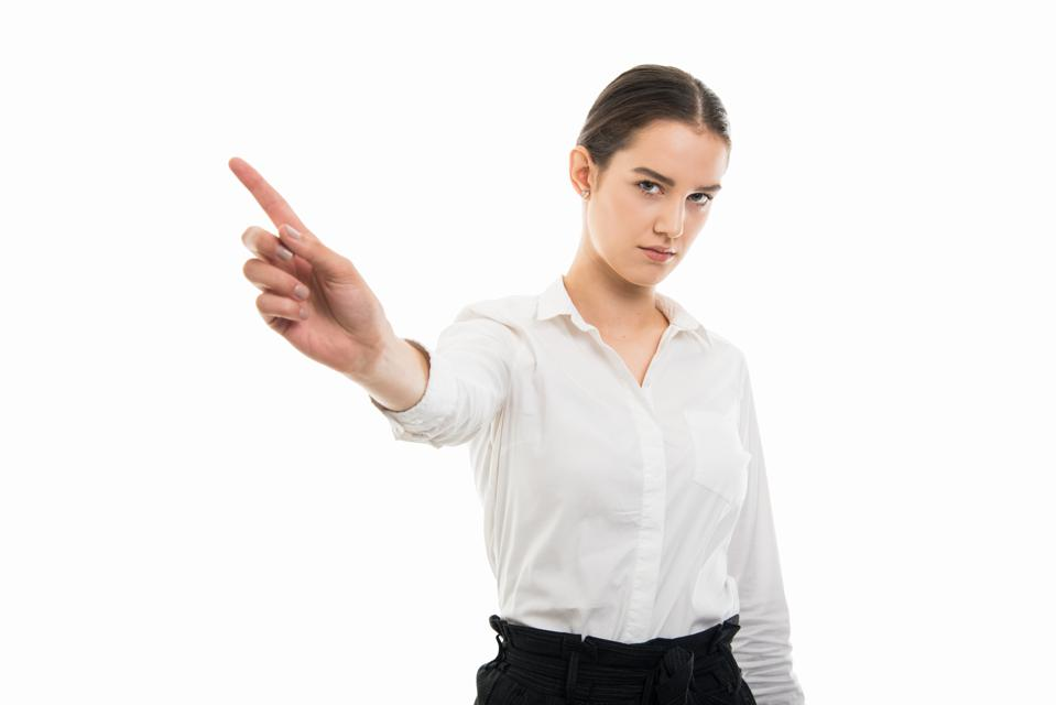Young business woman waving finger like no gesture