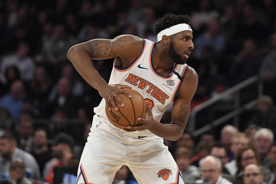 New York Knicks center Mitchell Robinson surveys the court during a February NBA game against the Indiana Pacers.
