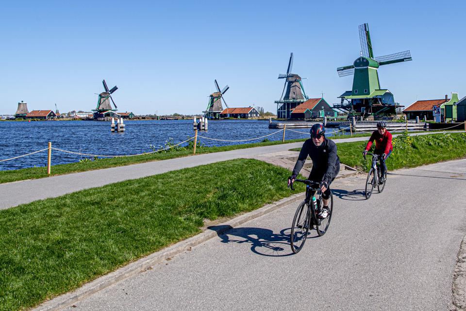 Cyclists riding along the deserted museum. The Zaanse Schans...