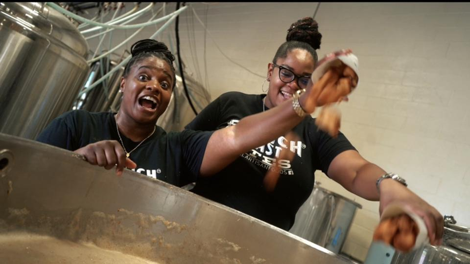 Charisse McGill (right) and business partner Kenisha McGill dumping French toast bites into the beer mash to make French Toast Bites Ale.