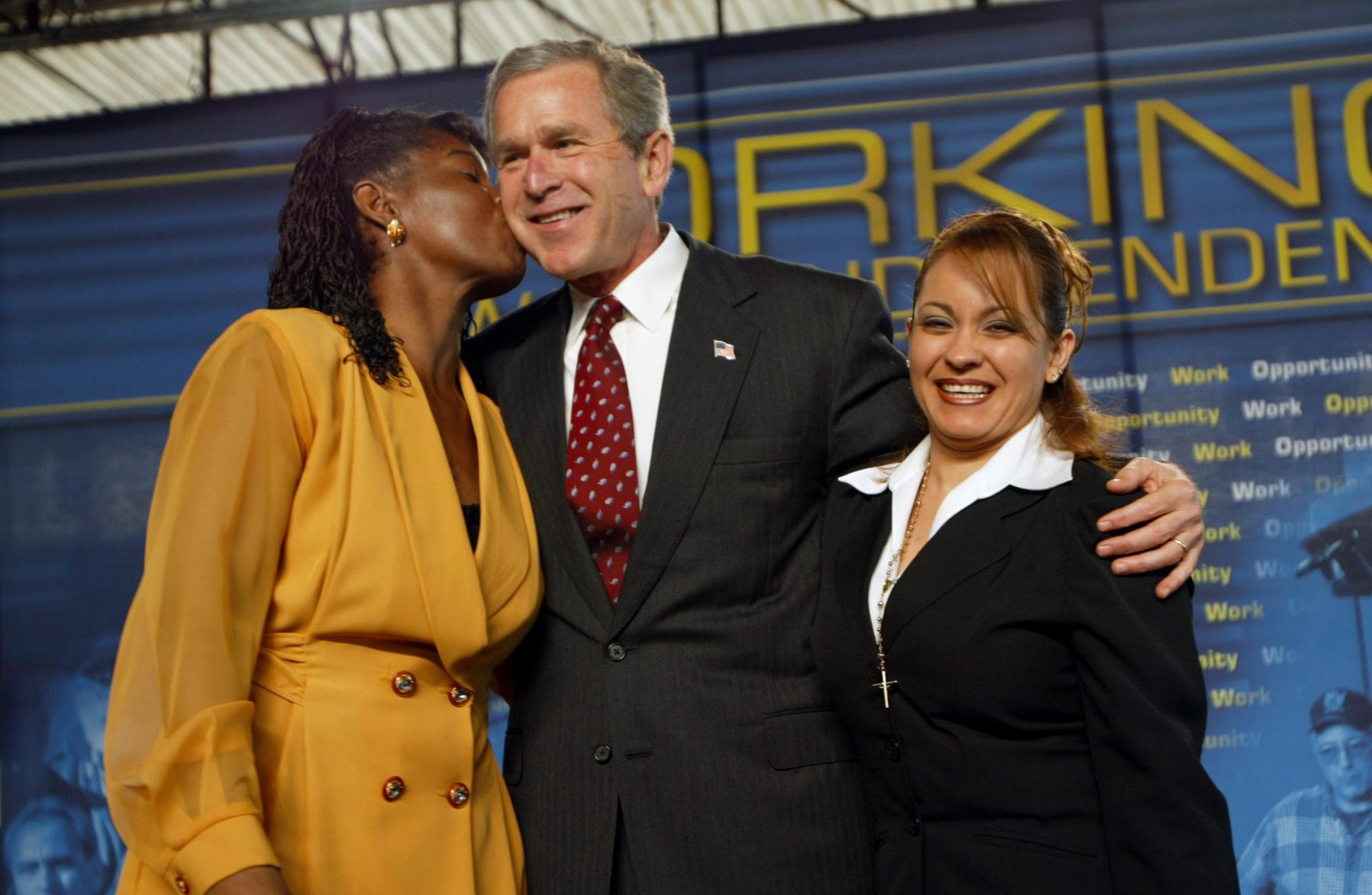 President George Bush Receiving Kiss