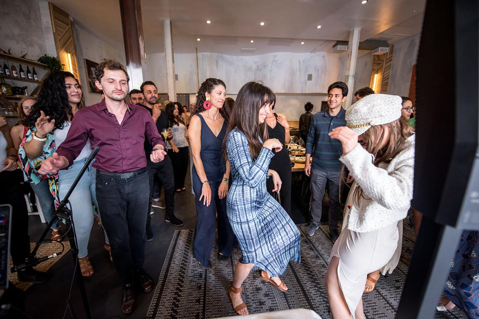 People dancing at one of Shuk Shuka's events.