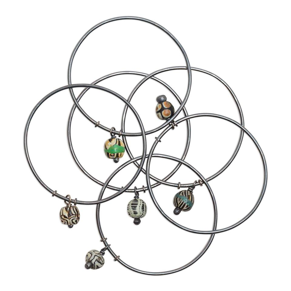 Sterling silver and ancient bead bangle bracelets by stôn.