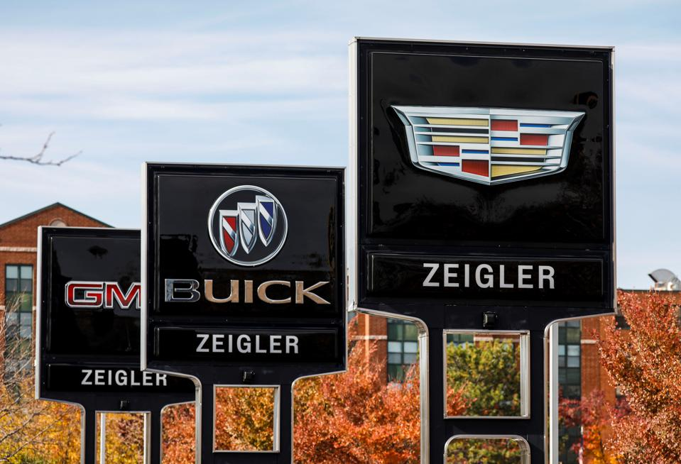 Signs at a Cadillac, Buick and GMC dealership in Illinois.