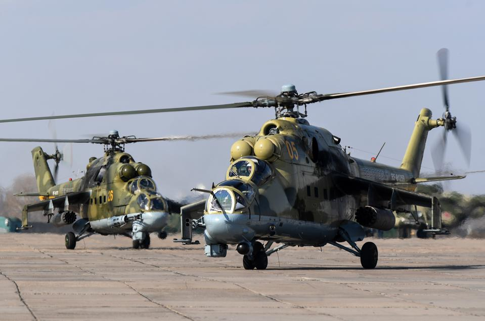 Attack helicopters perform training flights in Siberia