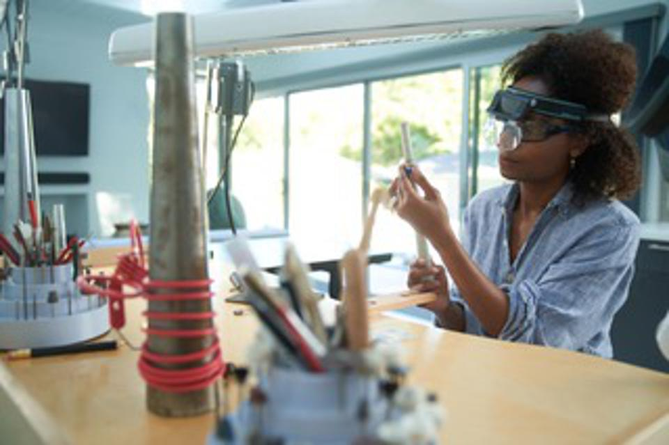 Designer Latondra Newton works on jewelry designs in her studio.
