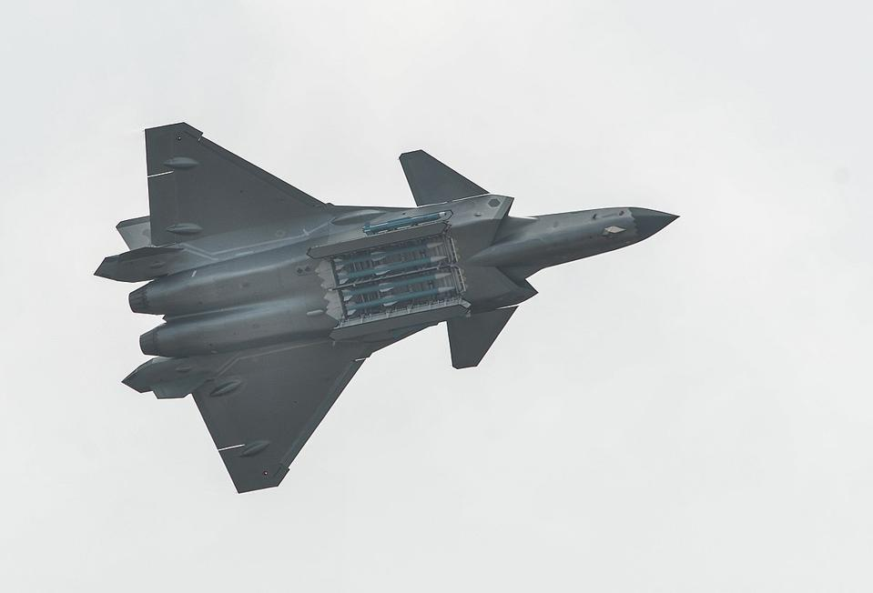 A J-20 stealth fighter at Zhuhai airshows with open weapons bay revealing PL-15 missiles