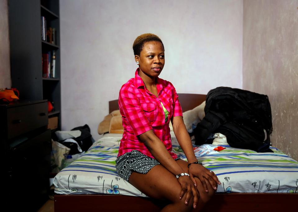 Blessing Obuson from Nigeria, 19, rescued from human traffickers, poses for a portrait in a shelter on the outskirts of Moscow.