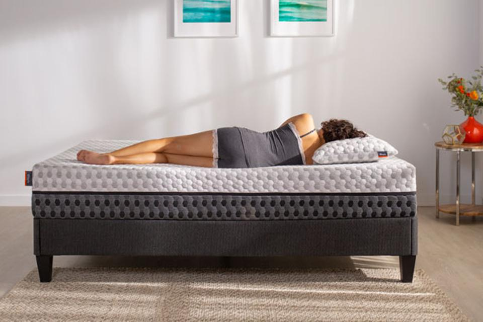 Woman sleeping on a Layla memory foam mattress