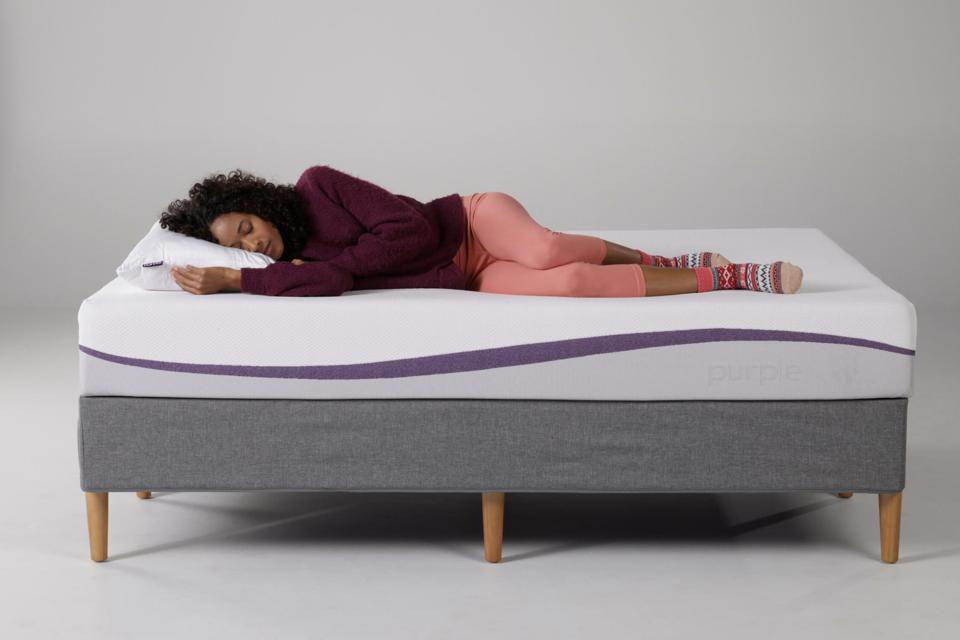 Woman sleeping on her side on a Purple mattress