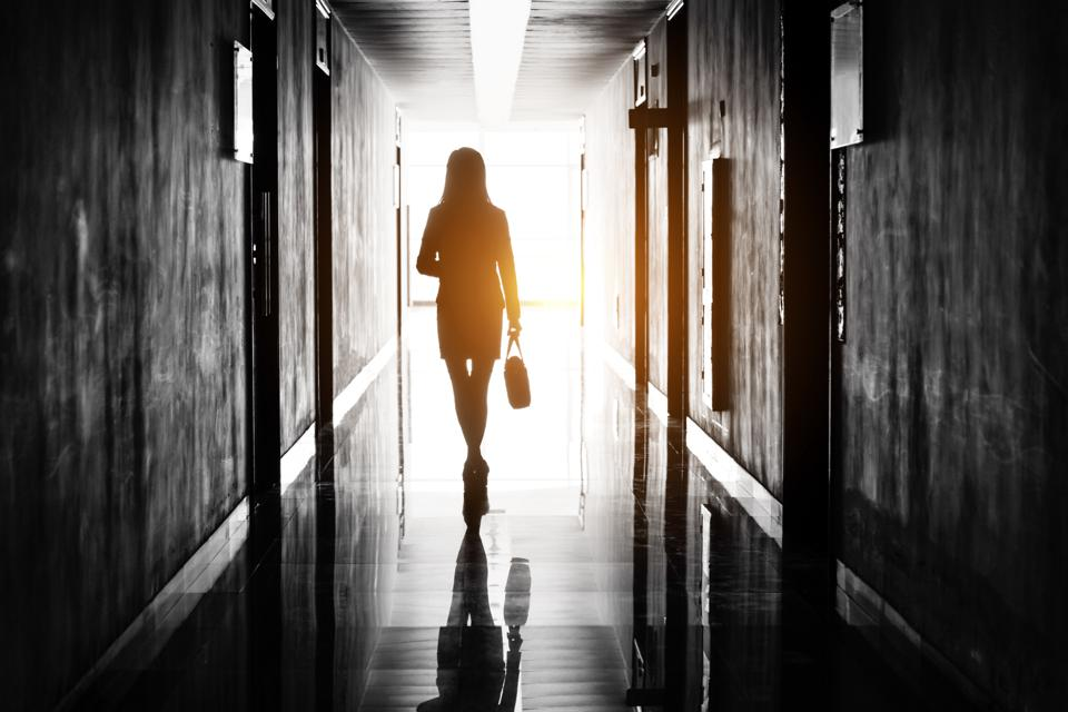 Businesswoman through the office corridor
