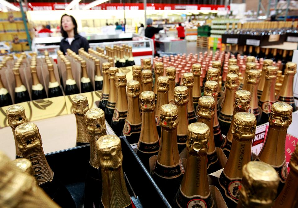 A Costco customer shops for champagne at a Costco store