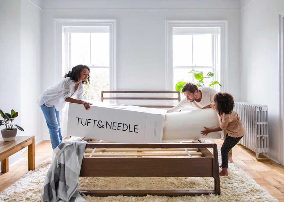 Family unboxing their Tuft & Needle mattress.
