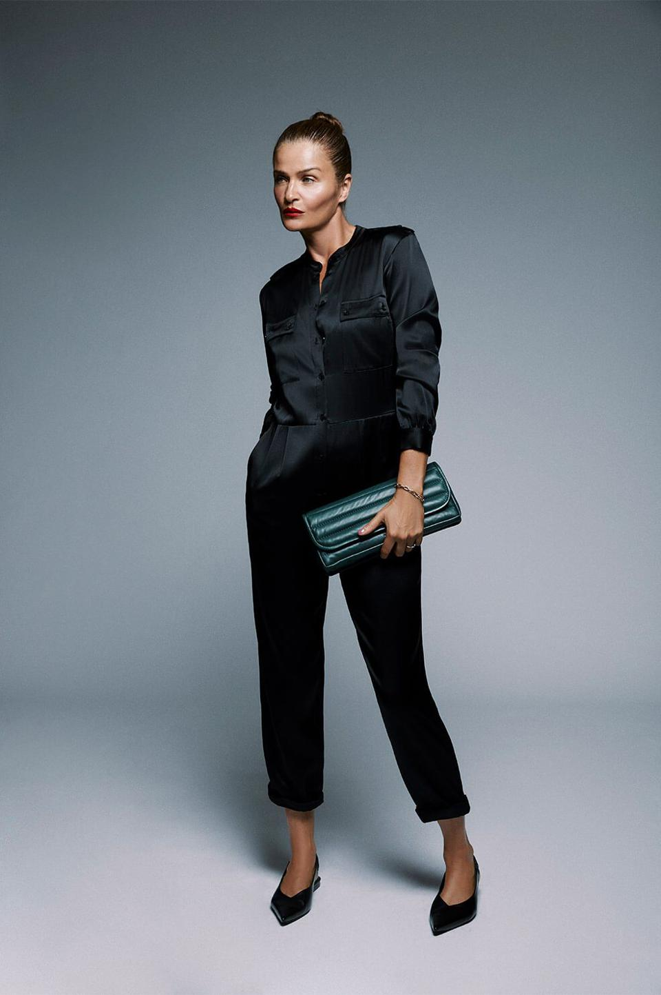 Helena Christensen models the Rosalie jumpsuit from her capsule collection collab with Anine Bing.