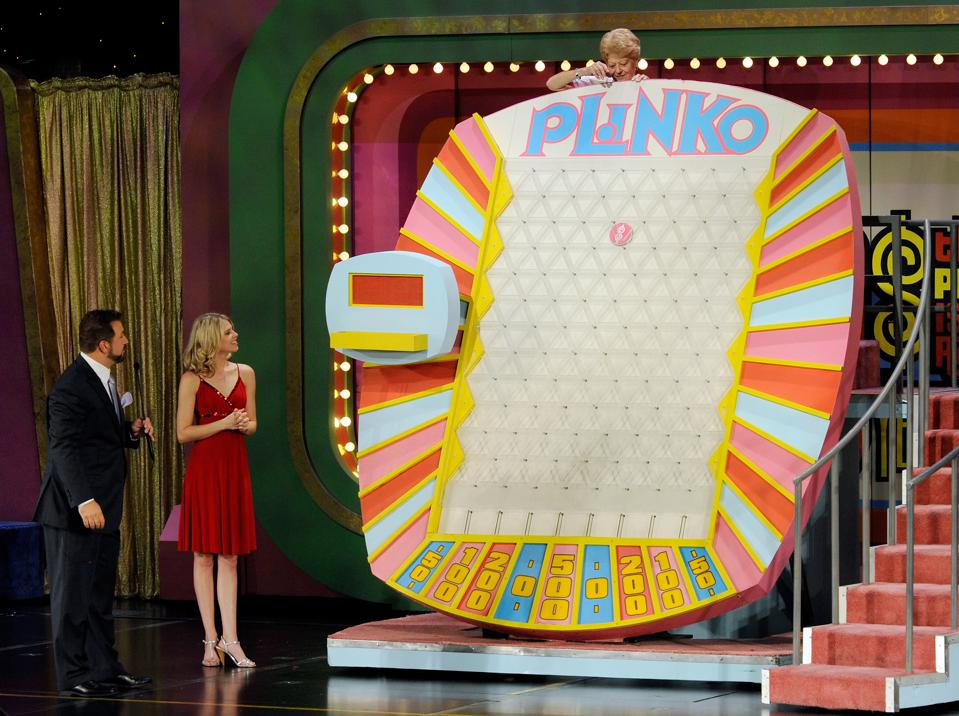 A game of Plinko on The Price Is Right in Las Vegas shows a contestant dropping a disc.