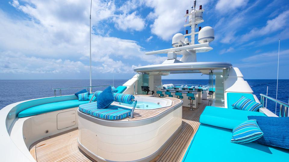 Large yachts are portable private islands with bars and pools!