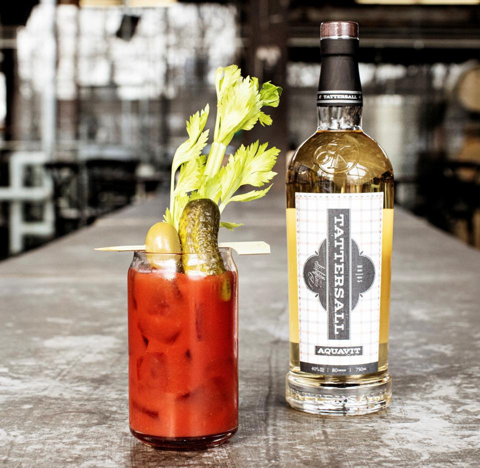Bottle of Tattersall Aquavit  and glass of Bloody Mary.