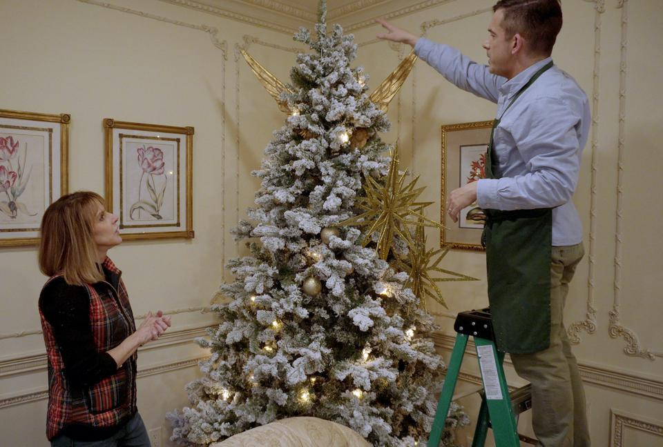 Benjamin Bradley (aka Mr. Christmas) and his dog Ebenezer star in the new Netflix reality series ″Holiday Home Makeover with Mr. Christmas″. Learn holiday home decorating tips. Christmas, holiday season, COVID-19, pandemic, DIY.