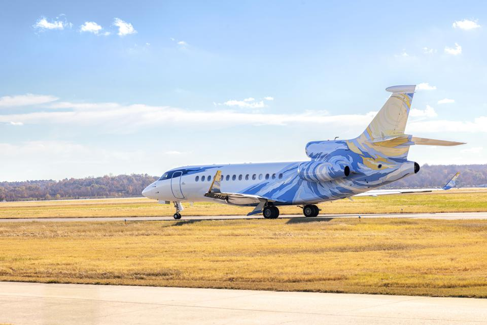 A blue- and yellow-colored plane exterior, customized by Winch Design.