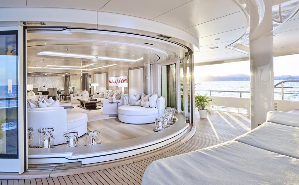 A stark-white living room and deck aboard superyacht New Secret.