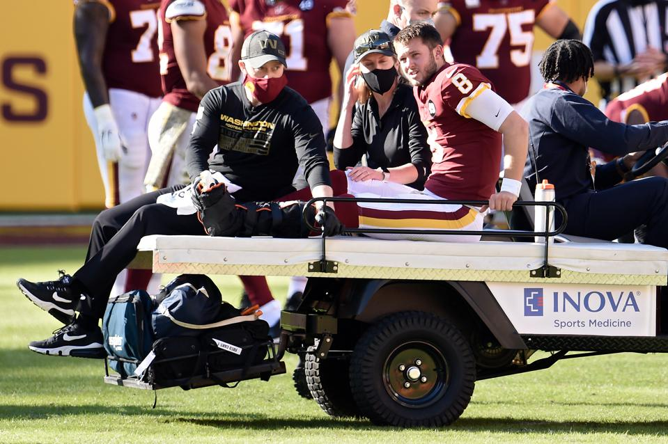 LANDOVER, MARYLAND - NOVEMBER 08: Kyle Allen #8 of the Washington Football Team is carted off the field after being injured in the first quarter against the New York Giants at FedExField on November 08, 2020 in Landover, Maryland.
