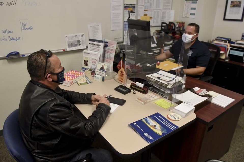 Offices install protections against coronavirus as they reopen.