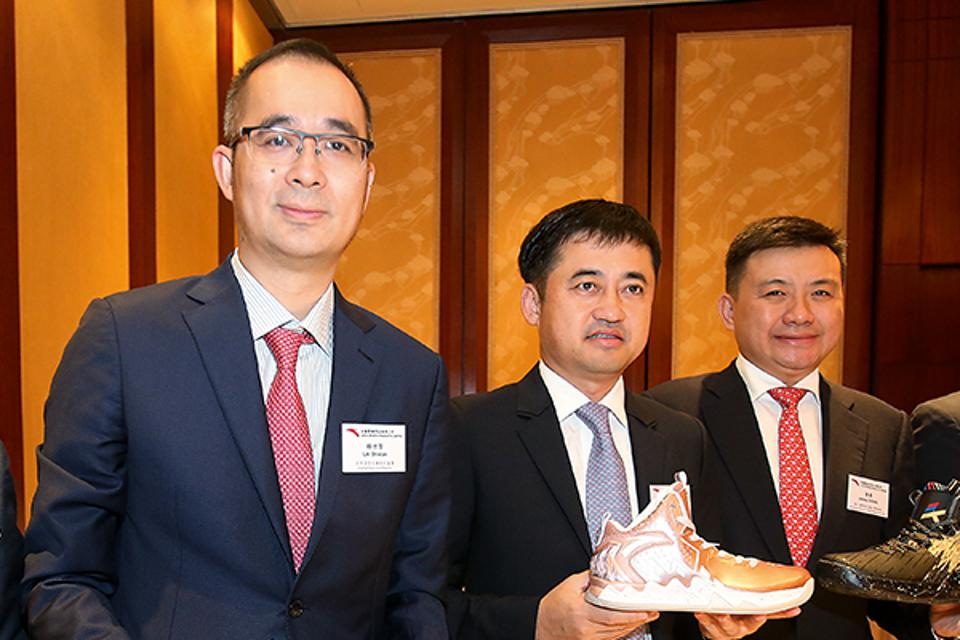 Ding Shizhong, chairman and CEO (center), Lai Shixian, COO and executive director (left) and Zheng Jie, Anta brand president and executive director, at Anta Sports Products' 2017 interim results announcement in Hong Kong.