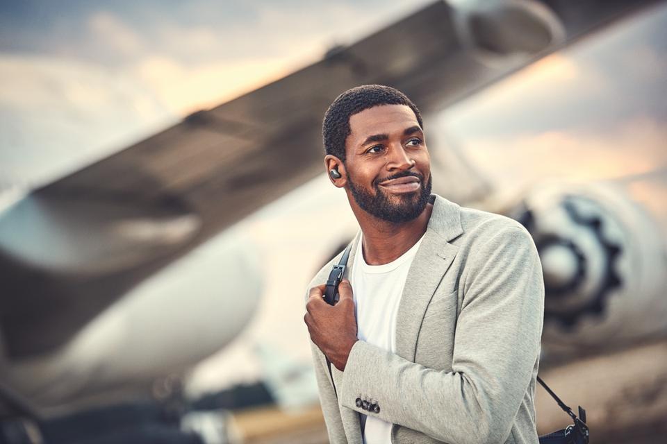 Man wearing Jabra Elite 85t earphones