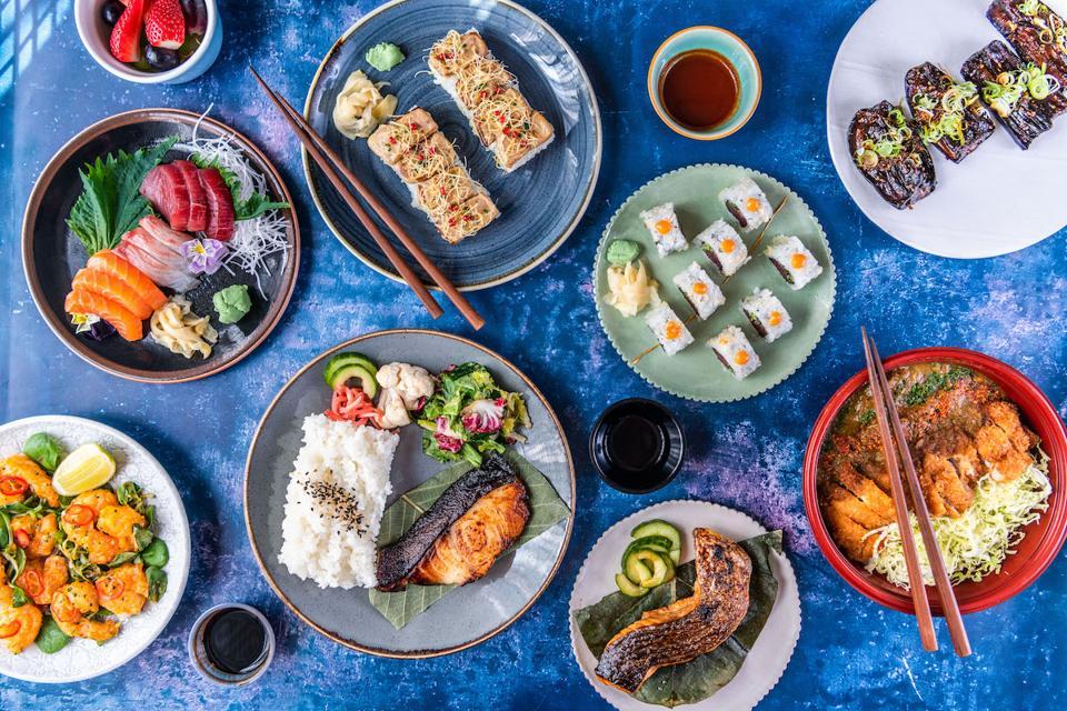 Japanese food dishes on blue background