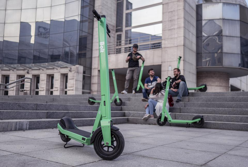 Green Bolt scooter with users